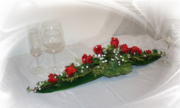 Gesteck rote rosen